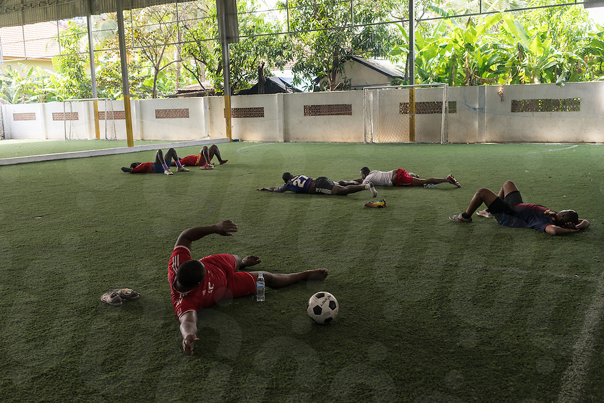 April 02, 2014 - Phnom Penh. Many football players who have not secured a contract with local football clubs - like 23-year old Nelson Olatunde Oladisi - train every morning on a synthetic field in the south of Phnom Penh to stay in shape. © Thomas Cristofoletti / Ruom