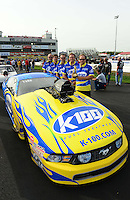 Sept. 30, 2012; Madison, IL, USA: NHRA pro mod driver Mike Janis poses for a photo with crew members after winning best appearing car during the Midwest Nationals at Gateway Motorsports Park. Mandatory Credit: Mark J. Rebilas-