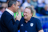 Reading manager Paul Clement greets Cardiff City manager Neil Warnock ahead of the Sky Bet Championship match between Cardiff City and Reading at the Cardiff City Stadium, Cardiff, Wales on 6 May 2018. Photo by Mark  Hawkins / PRiME Media Images.