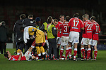 Wrexham 1 Brighton & Hove Albion 1, 18/01/2012. Racecourse Ground, FA Cup 3rd Round Replay. Wrexham players gathering on the pitch before the start of extra time against Brighton and Hove Albion in an FA Cup third round replay, at the Racecourse Ground played following the teams one-all draw in the first match. The replay was won by Brighton, 5-4 on penalty kicks after the match had ended in a one-all draw after extra time, watch by a crowd of 8316. The visitors played in the Championship, three leagues above their rivals from Wales, who were top of the Conference at the time of the match. Photo by Colin McPherson.