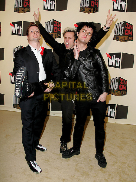 GREEN DAY - TRE COOL, MIKE DIRNT & BILLIE JOE ARMSTRONG.The VH1 Big in 04  Award Show held at The Shrine Auditorium in Los Angeles, California .December 1, 2004.full length, black leather jacket, gesture, splits, leg kicking, lifting, shoe, funny.www.capitalpictures.com.sales@capitalpictures.com.Supplied by Capital Pictures
