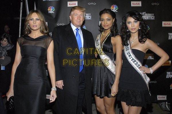 "MELANIE TRUMP, DONALD TRUMP, MISS USA RACHEL SMITH & MISS UNIVERSE RIYO MORI.Viewing party for ""The Celebrity Apprentice"" at Tenjune sponsored by Kodak, New York, New York, USA..February 7th, 2008.half 3/4 length black dress strapless sash hand on hip sheer sleeveless married husband wife.CAP/ADM/BL.©Bill Lyons/AdMedia/Capital Pictures. *** Local Caption ***"