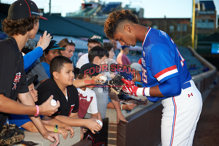Nander De Sedas (25) of Montverde High School in Montverde, Florida signs autographs before the Under Armour All-American Game presented by Baseball Factory on July 29, 2017 at Wrigley Field in Chicago, Illinois.  (Mike Janes/Four Seam Images)