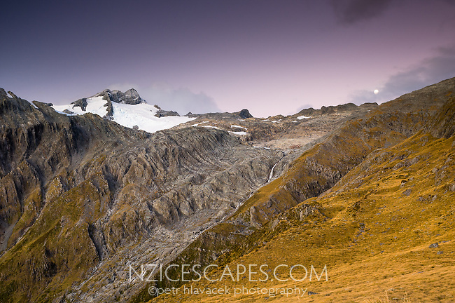 Sun setting on Mt. Brewster, Mt. Aspiring National Park, UNESCO World Heritage Area, Central Otago, New Zealand, NZ