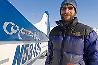 Pilot Dirk Nickisch, Coyote Air bush plane on skis at the Nuiqsut airport, Arctic North Slope, National Petroleum Reserve in Alaska.