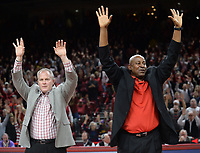 NWA Democrat-Gazette/ANDY SHUPE<br /> Arkansas athletics director Hunter Yurachek (left) and Razorback great Sydney Moncrief call the Hogs during a time out against LSU Friday, Jan. 11, 2019, during the first half of play in Bud Walton Arena in Fayetteville. Visit nwadg.com/photos to see more photographs from the game.