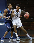 SIOUX FALLS, SD: MARCH 20:  Todd Withers #33 of Queens drives on De'Jon Davis #44 of Cal Baptist during their game at the 2018 Division II Men's Elite 8 Basketball Championship at the Sanford Pentagon in Sioux Falls, S.D. (Photo by Dick Carlson/Inertia)