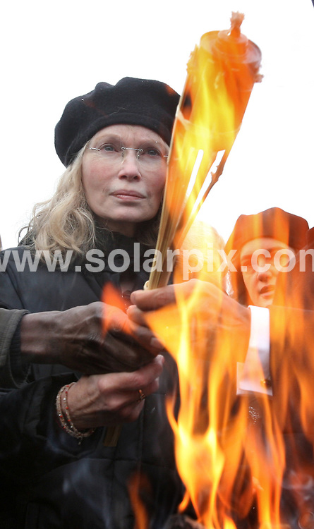 **ALL ROUND PICTURES FROM SOLARPIX.COM**.**SYNDICATION RIGHTS FOR UK AND SPAIN ONLY**.The UNICEF Embassador Mia Farrow lit a torch with other celebs to call attention to violation of human rights in the African country Darfur..This pic:MIA FARROW.JOB REF:5429-CPR        DATE:28_11_07.**MUST CREDIT SOLARPIX.COM OR DOUBLE FEE WILL BE CHARGED* *UNDER NO CIRCUMSTANCES IS THIS IMAGE TO BE REPRODUCED FOR ANY ONLINE EDITION WITHOUT PRIOR PERMISSION*