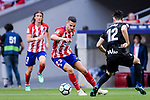 Victor Vitolo of Atletico de Madrid (L) in action against Paulo Oliveira of SD Eibar (R) during the La Liga match between Atletico Madrid and Eibar at Wanda Metropolitano Stadium on May 20, 2018 in Madrid, Spain. Photo by Diego Souto / Power Sport Images