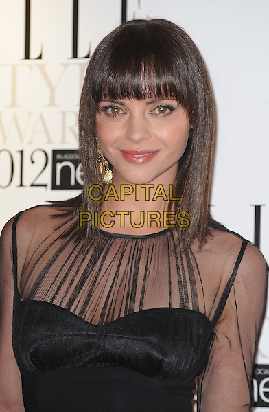 Christina Ricci.'Elle Style Awards 2012' at The savoy Hotel, London, England..13th February 2012.headshot portrait fringe bangs hair black sheer .CAP/WIZ.© Wizard/Capital Pictures.