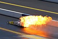 Sep 14, 2013; Charlotte, NC, USA; NHRA top alcohol dragster driver Mike Kosky fireballs an engine in flames during qualifying for the Carolina Nationals at zMax Dragway. Mandatory Credit: Mark J. Rebilas-