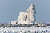 The Cleveland Harbor West Pierhead Light covered by frozen layers of ice. The lighthouse was encased in ice by crashing waves in frigid air temperatures during mid-December 2010.
