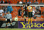17 July 2004: Brandon Prideaux (4) heads the ball away from Carlos Ruiz (20) while Troy Perkins (left) watches. Los Angeles Galaxy tied DC United 1-1 at RFK Stadium in Washington, DC during a regular season Major League Soccer game..