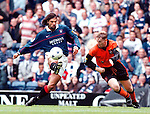 Rangers v Dundee Utd 23.8.97:  Marco Negri beats Dundee Utd's Stewart McKimmie and lobs the keeper from far out to score goal the third goal of the match