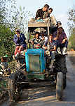 Men ride a tractor in the Egyptian village of Sakra.