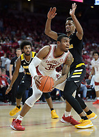 NWA Democrat-Gazette/ANDY SHUPE<br /> Arkansas forward Reggie Chaney (35) makes a move to the basket Saturday, Nov. 30, 2019, around Northern Kentucky forward Dantez Walton during the second half of play in Bud Walton Arena. Visit nwadg.com/photos to see more photographs from the game.
