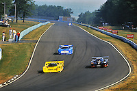 The Dyson Racing Porsche 962 driven by James Weaver leads a group of cars during the 1991 IMSA race at Watkins Glen, New York.