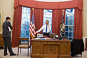United States President Barack Obama talks on the phone with House Speaker John Boehner in the Oval Office, April 8, 2011. Office of Management and Budget  Director Jack Lew listens at left. .Mandatory Credit: Pete Souza - White House via CNP