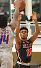 Julien Crittendon #10 of Half Hollow Hills East, right, shoots a jumper as Darius Lee #44 of St. Raymond (Bronx) contests the shot during a non-league varsity boys basketball game in the Gary Charles Hoop Classic at Adelphi University on Sunday, Jan. 7, 2018. St. Raymond defeated Hills East by a score of 82-72.