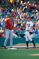 Indianapolis Indians third baseman Kevin Kramer (17) talks with Rochester Red Wings manager Joel Skinner (35) during a game against the Rochester Red Wings on July 24, 2018 at Victory Field in Indianapolis, Indiana.  Rochester defeated Indianapolis 2-0.  (Mike Janes/Four Seam Images)