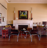 A pair of steel and leather armchairs gives the comfortable living room a contemporary flair