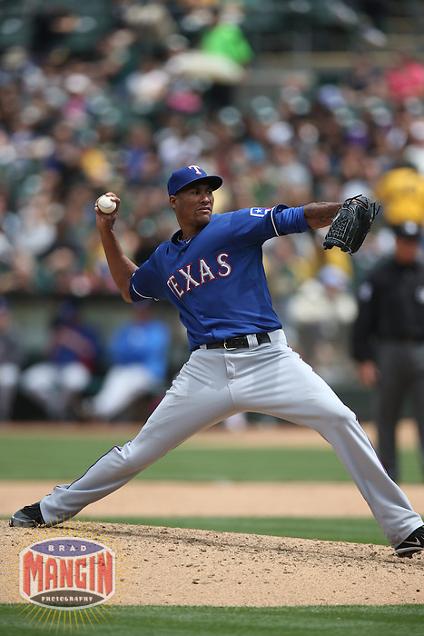 OAKLAND, CA - MAY 15:  Alexi Ogando #41 of the Texas Rangers pitches against the Oakland Athletics during the game at O.co Coliseum on Wednesday May 15, 2013 in Oakland, California. Photo by Brad Mangin