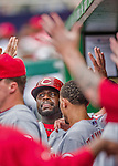 21 May 2014: Cincinnati Reds second baseman Brandon Phillips comes into the dugout after scoring against the Washington Nationals at Nationals Park in Washington, DC. The Reds edged out the Nationals 2-1 to take the rubber match of their 3-game series. Mandatory Credit: Ed Wolfstein Photo *** RAW (NEF) Image File Available ***