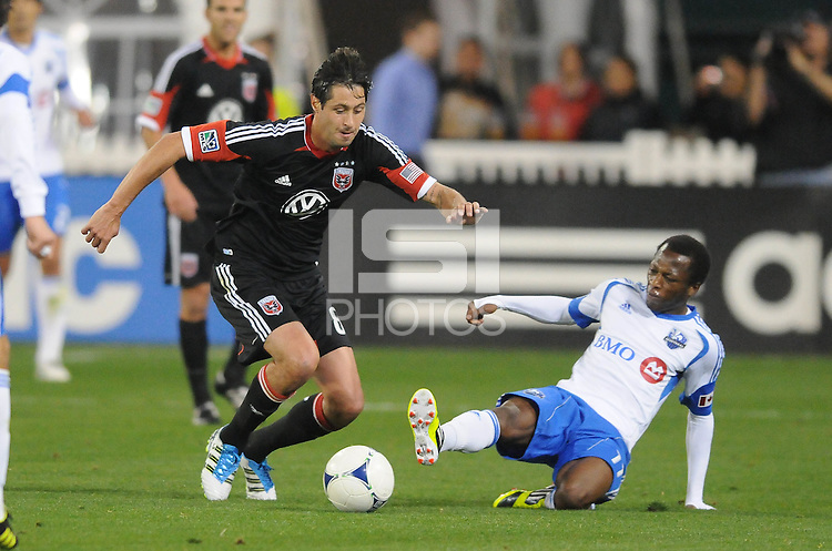 D.C. United midfielder Branko Boskovic (8) goes against Montreal Impact forward Sanna Nyassi (11) D.C. United tied The Montreal Impact 1-1, at RFK Stadium, Wednesday April 18 , 2012.