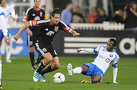 D.C. United midfielder Branko Boskovic (8) goes against Montreal Impact forward Sanna Nyassi (11) D.C. United tied The Montreal Impact 1-1, at RFK Stadium, Wednesday April 18 , 2012.