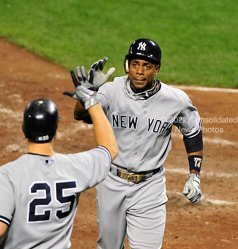 New York Yankees centerfielder Curtis Granderson (14) is congratulated by first baseman Mark Teixeira (25) after homering in the seventh inning against the Baltimore Orioles at Oriole Park at Camden Yards in Baltimore, Maryland in the second game of a doubleheader on Sunday, August 28, 2011.  The Yankees won the game 8 - 3, earning a split in the two games..Credit: Ron Sachs / CNP.(RESTRICTION: NO New York or New Jersey Newspapers or newspapers within a 75 mile radius of New York City)