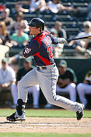 Travis Buck #28 of the Cleveland Indians bats against the Oakland Athletics in a spring training game at Phoenix Municipal Stadium on March 2, 2011  in Phoenix, Arizona. .Photo by:  Bill Mitchell/Four Seam Images.