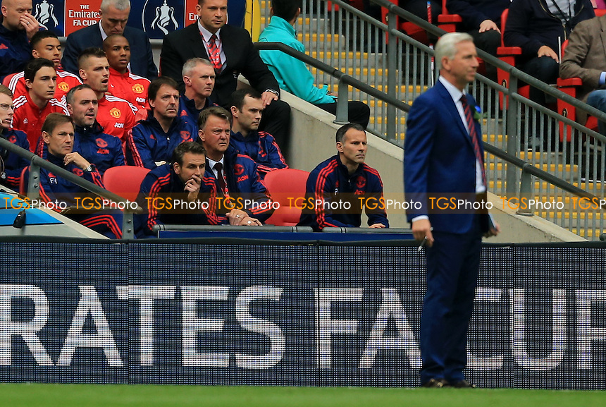 Manchester United manager Louis Van Gaal sits unanimated in the Manchester United dugout during Crystal Palace vs Manchester United, Emirates FA Cup Final Football at Wembley Stadium on 21st May 2016