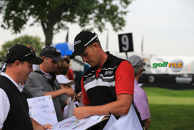 Henrik Stemson (SWE) signs autographs for fans during Wednesday's Practice Day of the 2013 Bridgestone Invitational WGC tournament held at the Firestone Country Club, Akron, Ohio. 31st July 2013.<br /> Picture: Eoin Clarke www.golffile.ie