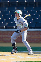 Corey Bird (31) of the Marshall Thundering Herd follows through on his swing against the Georgetown Hoyas at Wake Forest Baseball Park on February 15, 2014 in Winston-Salem, North Carolina.  The Thundering Herd defeated the Hoyas 5-1.  (Brian Westerholt/Four Seam Images)