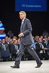 © Joel Goodman - 07973 332324 . No syndication permitted . 29/09/2013 . Manchester , UK . PHILIP HAMMOND exits the stage . Day 1 of the Conservative Party Conference at Manchester Central . Photo credit : Joel Goodman