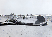 BNPS.co.uk (01202 558833)<br /> Pic: PhilYeomans/BNPS<br /> <br /> Crash landing for a RAF photo-recon Spitfire in Africa.<br /> <br /> Unearthed - fascinating unseen archive of cameras, photographs, documents and medals from a British aerial reconnaisance expert who fought all the way through Africa and southern Europe in WW2.<br /> <br /> Flt Lt Eric Cooper from London kept all his wartime paraphernalia, including his K20 handheld camera and stereoscopic plotting instruments until his death in Devon aged 96 in 2012.<br /> <br /> The incredible photographs show bombing raids, amphibious landings and badly damaged aircraft alongside off duty snaps of the campaign throughout the mediterraenean.<br /> <br /> His nephew is now selling the compelling collection at Plymouth Auction Rooms in Devon next week.