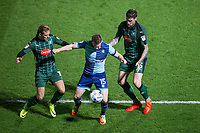 Dayle Southwell of Wycombe Wanderers holds off Oscar Threlkeld (left) & Sonny Bradley of Plymouth Argyle during the Sky Bet League 2 match between Wycombe Wanderers and Plymouth Argyle at Adams Park, High Wycombe, England on 14 March 2017. Photo by Andy Rowland / PRiME Media Images.