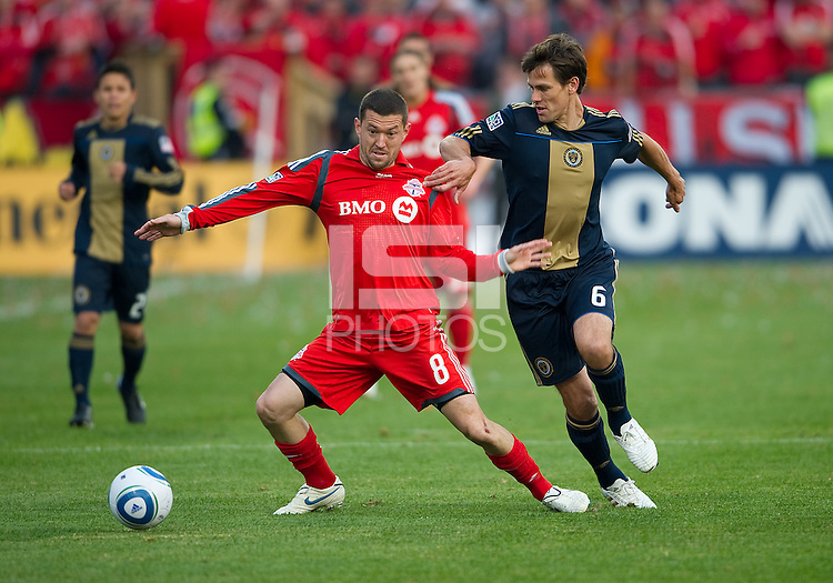 15 April 2010: Philadelphia Union midfielder Stefani Miglioranzi #6 and Toronto FC forward Dan Gargan battle for a ball during a game between the Philadelphia Union and Toronto FC at BMO Field in Toronto..Toronto FC won 2-1..Photo by Nick Turchiaro/isiphotos.com........12 September 2009:Toronto FC forward Chad Barrett # 19 takes the ball up field during MLS action at BMO Field Toronto in a game between Colorado Rapids and Toronto FC. .Photo by Nick Turchiaro/isiphotos.comApril 12 2010: Chicago White Sox second baseman Gordon Beckham #15 and Chicago White Sox shortstop Omar Vizquel #11celebrate the win during the Toronto Blue Jays home opener between the Chicago White Sox and the Toronto Blue Jays at Rogers Centre in Toronto, Ontario..The White Sox won 8-7 in 11 innings.........11 April 2009:Toronto FC forward Chad Barrett # 19 takes the ball up field during MLS action at BMO Field Toronto, in a game between FC Dallas and Toronto FC. .Toronto FC won 2-1.