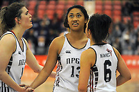 Theresa Hunt is congratulated by NPGHS teammates during the 2014 National Secondary Schools Basketball Championship AA girls' semifinal between New Plymouth Girls' High School and St Peter's College Cambridge at Arena Manawatu, Palmerston North, New Zealand on Friday, 3 October 2014. Photo: Dave Lintott / lintottphoto.co.nz