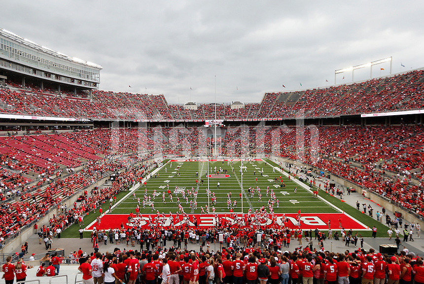 The Ohio State Buckeyes take the field for warm ups before the college football game between the Ohio State Buckeyes and the Northern Illinois Huskies at Ohio Stadium in Columbus, Saturday afternoon, September 19, 2015. (The Columbus Dispatch / Eamon Queeney)