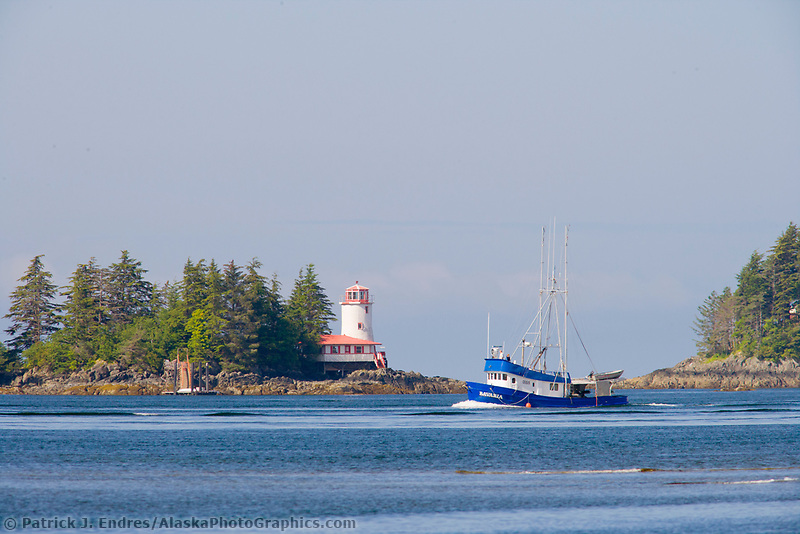 Commercial fishing boat. Rockwell Lighthouse is located on Rockwell Island in the Sitka Sound, AK. It was built in 1977 and still operates as a Bed and Breakfast inn. Coastal community of Sitka located on Baranof Island in Alaska's southeast panhandle.