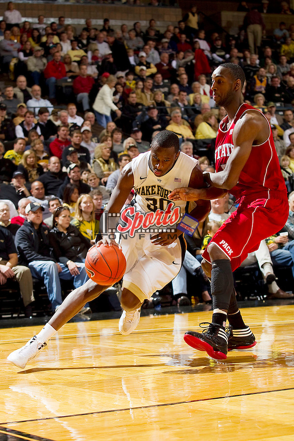 Travis McKie #30 of the Wake Forest Demon Deacons tries to drive the baseline past C.J. Leslie #5 of the North Carolina State Wolfpack at the LJVM Coliseum on January 14, 2012 in Winston-Salem, North Carolina.  The Wolfpack defeated the Demon Deacons 76-40.  (Brian Westerholt / Sports On Film)
