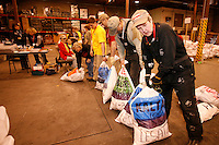 Tuesday February 16, 2010.  Volunteers weigh, tag and sort musher's dog food and supply bags to send out to the 22 checkpoints along the 2010 Iditarod trail.