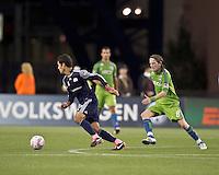 New England Revolution midfielder Benny Feilhaber (22) dribbles as Seattle Sounders midfielder Erik Friberg (8) defends. In a Major League Soccer (MLS) match, the Seattle Sounders FC defeated the New England Revolution, 2-1, at Gillette Stadium on October 1, 2011.