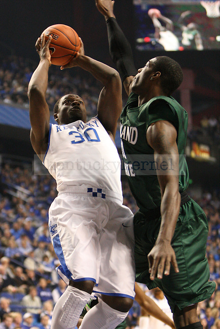 UK forward Julius Randle jumps to shoot the ball against Cleveland State forward Marlin Mason during the first half of the University of Kentucky men's basketball game vs. Cleveland State at Rupp Arena in Lexington, Ky., on Monday, November 25, 2013. UK won 68-61. Photo by Tessa Lighty | Staff