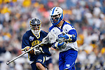 FOXBORO, MA - MAY 28: Chris Clancy (16) of the Limestone Saints loses his stick while being guarded by James Bassett (36) of the Merrimack Warriors during the Division II Men's Lacrosse Championship held at Gillette Stadium on May 28, 2017 in Foxboro, Massachusetts. (Photo by Larry French/NCAA Photos via Getty Images)