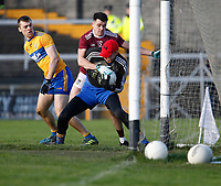 26th January 2020; TEG Cusack Park, Mullingar, Westmeath, Ireland; Allianz Football Division 2 Gaelic Football, Westmeath versus Clare; Clare goalkeeper Stephen Ryan holds on to the ball under pressure from Westmeath forward David Lynch