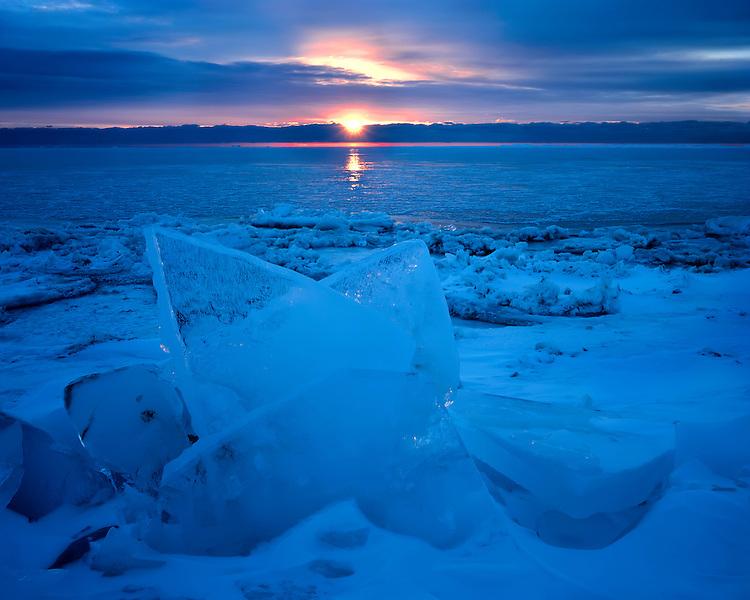 Sunrise light on the frozen shore of Lake Michigan; Newport State Park, WI