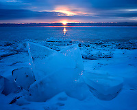 Sunrise light on the frozen shore of Lake Michigan; Newport State Park, WI