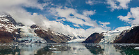 Clouds hang over the Chugach mountains and Barry, Coxe and Cascade glacier in Prince William Sound, Alaska.